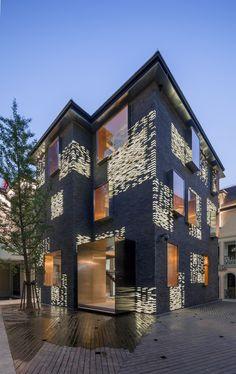 Façade Renovation for No. 8 Building- China- Atelier Archmixing- traditional gray bricks mixing with unique luminous bricks