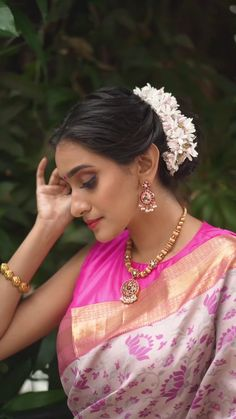 Our beautiful pink Parampara pattu saree replenishes the season of celebrations, which when paired with a high-neck sleeveless blouse makes it trendy. Enhance your look with a gold beaded neckpiece. For the hairdo, make an evergreen Mallipoo hair bun. #grandsaree #silksaree #puresilk #saree #traditionalsaree #sareedesigns #sareestyling #weddingsaree #puresilksaree #sareedraping #jewellery #draping#paramparasilksaree #paramparasarees #handloomsaree #bridalsaree #sareeembroidery #pattusaree Red Saree, Saree Blouse, Sleeveless Blouse, Dress Indian Style, Traditional Sarees, Pure Silk Sarees, Handloom Saree, Saree Styles, Saree Wedding