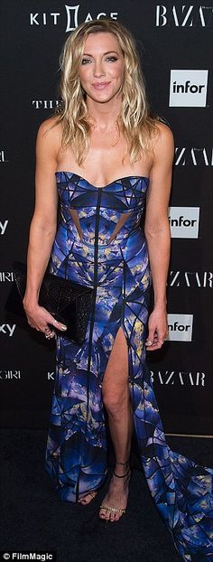 Turning up the glam: Katie Cassidy showed some leg in her Gabriela Cadena blue print dress whileHilary Rh...