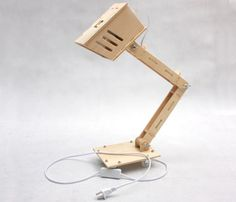 Plywood desk lamp: most stupid idea ever. It would over heat and burn your house down. Come on people.