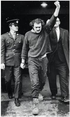Paul Rose, a member of the Front de liberation du Quebec (FLQ), defiantly raising his fist while leaving court during his trial for the murder of provincial minister Jacque Laporte. Mr. Rose and other members of the FLQ kidnapped Mr. Laporte after Canada refused to meet the group's demands to release FLQ prisoners after an earlier kidnapping. Mr. Rose was found guilty in March 1971 and served 13 years of a life sentence. He died at the age of 69 on March 14, 2013.