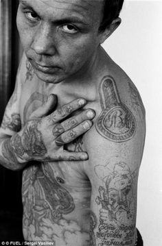 A high-ranking, authoritative thief. In the early 1950s, it became customary for thieves to tattoo dots or small crosses on the knuckles, the number of dots indicating the number of terms. Prison is this thief's home, he is of the highest rank in the thieves' social hierarchy. His ring tattoos show that he was the only underage detainee in his circle of thieves, and that he is an 'anti-social': an inveterate transgressor of the prison regime, who completely refuses to work