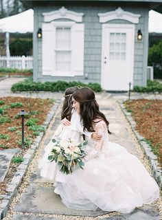 A heart-melting flower girl hug:  Photography : Graham Terhune Photography Read More on SMP: http://www.stylemepretty.com/2016/07/14/cozy-and-elegant-old-edwards-inn-wedding/