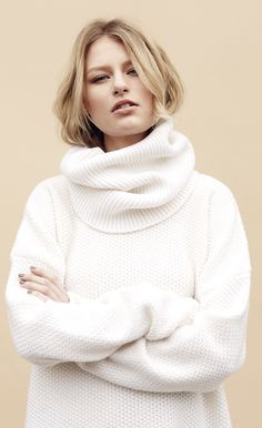Encase yourself in comfort with this White Wool Rich Drop Shoulder Longline Jumper with Snood. Ideal for autumn & winter days.
