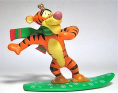 "Tigger is all prepared when ""Snow Day"" is declared. TIGGER ON SNOWBOARD ORNAMENT (by Grolier) (from Walt Disney's ""Winnie the Pooh"")"