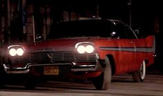 Christine coming back for more. screen capture from the movie Christine 1983 (1958 Plymouth Belvedere / Fury 2 door hardtop)