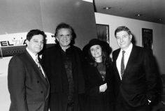 Music legend Johnny Cash (center), dressed in black, and his wife June Carter Cash, with representatives from El Al airlines.
