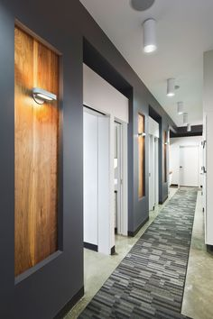 I like the wood inset panels, the hall carpet, the lighting-this whole hallway is nice Dental Office Design, Office Interior Design, Office Interiors, Corporate Interiors, Clinic Design, Commercial Design, Commercial Interiors, Chiropractic Office Design, Shopping