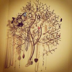 My newest project, just finished.  Iron tree hung by my closet with accessories! :)