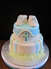 Baby Boy Baptism cake or baby boy shower cake. Love the little shoes on the top!