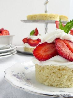 Low Carb Strawberry Shortcakes with whipped cream and fresh sliced berries. For a dairy-free topping, use Whipped Coconut Cream. | Low Carb, Gluten-free, Diary-free, Paleo & Keto | momcanihavethat.com