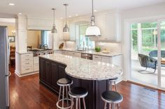 Interesting Kitchen Designs with Islands for Your Home: Marble Countertop With Industrial Bar Stools And Pendant Lighting For Traditional Kitchen Designs With Islands And White Kitchen Cabinets Plus Ceiling Lights Also Dark Wood Floor ~ idobrich.com Architecture & Home Design Inspiration