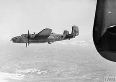 Mitchell Mark II, of No. 98 Squadron RAF based at Dunsfold, Surrey, approaches the English Channel south of Etaples while returning from a 'Noball' operation over northern France. Note the deployed ventral turret. Military Helicopter, Military Aircraft, Raf Bases, Heavy Cruiser, Vintage Airplanes, Ww2 Aircraft, Nose Art, Royal Air Force, Interesting History