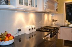 My kitchen, press tin wallpaper with super tough clear glass over the top as a splashback. No grout to clean