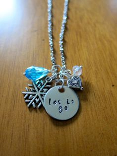 """Disney Frozen Necklace inspired by Elsa. """"Let It Go"""" Necklace by WithLoveFromOC, and free shipping.  Silver colored with blue and white Swarovski crystal charms and a heart and snowflake charm. This is the perfect Frozen necklace for a gift."""