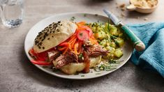 Short rib bao burger and spicy cucumber salad