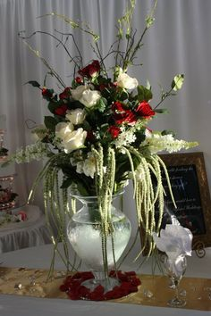 Aglow Weddings & Events.  Extra large red and white floral display.  Stunning!