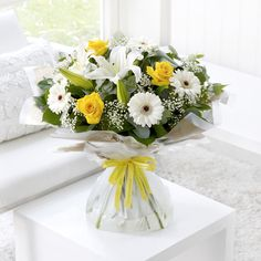 Send your congratulations with this dazzling yellow and white bouquet.