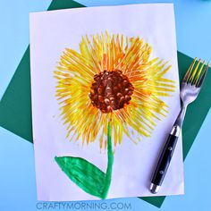 Make a sunflower craft using fork prints and paint! It's a great spring craft for kids.