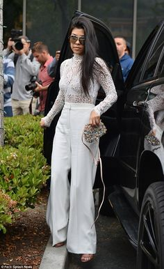 White hot: Kourtney Kardashian arrived to California Community Church in Agoura Hills on E...