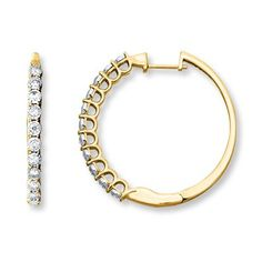 Sparkling round diamonds adorn these yellow gold hoop earrings, perfect for a fall look, day or night.
