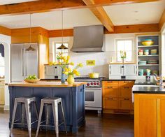 Warm wood accents add contrast to this colorful kitchen. More kitchen ideas: http://www.bhg.com/decorating/decorating-photos/kitchen/?socsrc=bhgpin042913warmwoodkitchen
