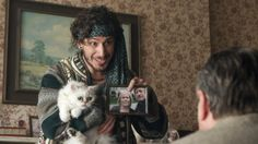"""Cuckoo (Andy Samberg) startles everyone, especially Floxsie the cat, when he announces she is the reincarnation of Tony's late wife in the dark British comedy Cuckoo episode """"Grandfather's Cat"""" (2012) which also comes with a Kitty Carnage Warning."""