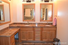 Cherry vanity with off set lower vanity area and matching mirror frames.