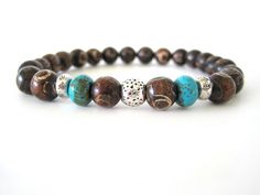 Very hip men's bracelet featuring 8mm Mongolian agate beads, turquoise magnesite heishi rondelle beads and pewter accent beads. The agate beads are so cool with unique patterns on each bead making this quite the statement piece. A rugged men's bracelet any guy would love!