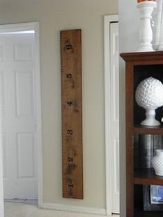 measuring stick to track your kids & vistiors height... did this on the wall at home (can't take a wall with you from home to home)