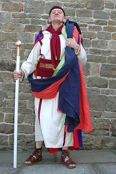 An member of the College of Augurs dressed in a long-sleeved tunica angusticlavia and a colourful toga trabea