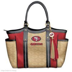 NFL-licensed custom-designed shoulder tote with team logo in designer pattern. Team color poly twill, faux leather handles and logo charm tassel.