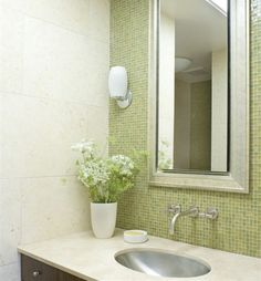 Fresh lemon green mosaic adds a kind of natural breath to this space.