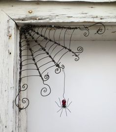 "Czechoslovakian Red Spider Dangles From 12""  Barbed Wire Corner Spider Web"