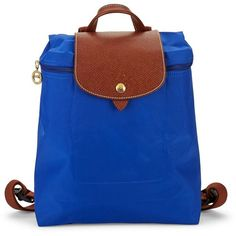 Longchamp Le Pliage PVC Coated Backpack ($100) ❤ liked on Polyvore featuring bags, backpacks, pvc backpack, blue backpack, strap bag, day pack backpack and pvc bag