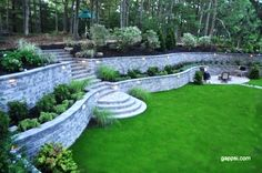 The Nicolock Firma Wall is a segmental retaining wall unit with a natural split-face texture. Firma Walls may be built with straight or radius walls, corners and steps with the standard wall unit. The Firma Wall's patented locking system will conform to every landscape plan. Its classic look complements any natural environment. The neutral color of this stone makes the green grass and landscaping stand out. The lights create a nice scenery at night. http://www.gappsi.com/?p=21636