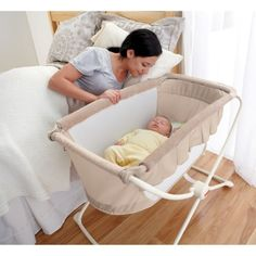 Fisher-Price Deluxe Rock n' Play Portable Bassinet...something simple and rockable like this would be way nice.