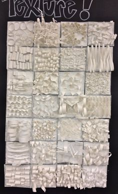 love this. Students use white paper to create texture relief sculptures.