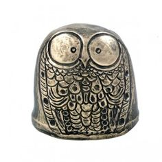 """The owl is a symbol of the Greek goddess Athena, who was reputed to know all at a glance; she was goddess of wisdom, learning and augury. Cast iron with bronze shell. 3.25"""" tall. Wild Goose Studios, Kinsale Ireland"""