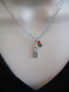 Celebrate your sorority with this fashionable necklace featuring your letters and sorority colors! Officially Licensed.  17 inch chain sorority necklace features a sterling silver plated Greek letter Alpha Chi Omega lavaliere (1/4Wx 3/4L) and a red 4mm Swarovski crystal and olive 4mm Swarovski crystal bead dangle. Chain and lobster clasp are both base metal alloy. Perfect gift for sorority initiation, Bigs and Littles, new pledges, holidays and birthdays, or just because! Additional...
