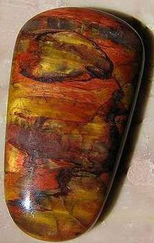 Binghamite. Chalcedony with dense, parallel inclusions of Goethite. Its color is a multicolored yellowish to reddish, and it exhibits chatoyancy. Binghamite was found in the Cuyuna Iron Range in Minnesota, and is used as a rare gemstone.