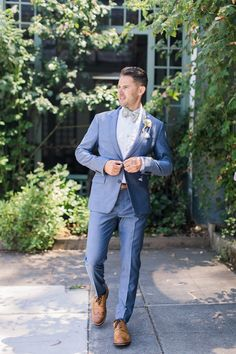 Wedding Suits groom in blue grey suite with sage bow tie - With fresh flowers everywhere and a lovely garden venue, this wedding will stave off those Winter blues. Blue Suit Wedding, Wedding Men, Wedding Attire, Wedding Styles, Wedding Groom, Wedding Favors, Black Satin Shirt, Mens White Suit, Bow Tie Suit