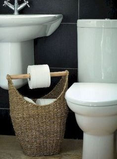 Kill two birds with one stone by turning a basket into a toilet paper organizer and dispenser for your bathroom. While you might be able to DIY this with a basket and a wooden dowel, you can buy this exact piece here. Rustic Bathroom Shelves, Rv Bathroom, Bathroom Storage Shelves, Bathroom Organization, Bathroom Renovations, Diy Storage, Storage Ideas, Bathroom Ideas, Bathroom Interior