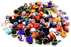 An image showing one of each type of polychrome bead available from our online shop at www.tillermanbeads.co.uk