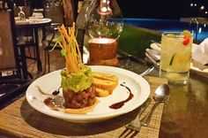 Tuna tartare topped with mashed avocado and sesame-soy sauce, accompanied by toasted home-made bread. 1942 Restaurant Islita, Guanacaste Costa Rica