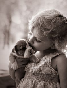 little girl and puppy.