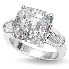 This is our classic style solitaire engagement ring featuring an Asscher Cut cubic zirconia center stone with two tapered baguettes on each side. Available in 14K white or yellow gold.  Model 2128A