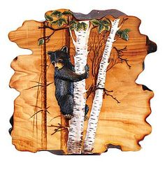 This unique piece of Intarsia wood art features a lone bear cub tree looking down at the world below him. This Intarsia style of wood art is made from several species of wood and hand painted to give a realistic 3-D appearance. Due to the hand crafted nature of this item, materials and color may vary slightly.