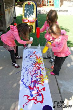 Painting with squirt bottles. Fill up some condiment bottles with paint and squeeze to create works of art.