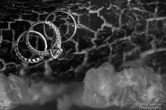 Wedding rings on burnt wood